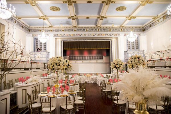 A view of the stage and floor in the Crystal Ballroom from the second tier seating area.